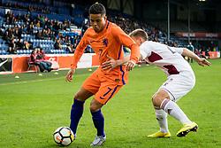 (L-R) Justin Kluivert of Jong Oranje, Sorokins Vladislavs of Jong Letland during the EURO U21 2017 qualifying match between Netherlands U21 and Latvia U21 at the Vijverberg stadium on October 06, 2017 in Doetinchem, The Netherlands