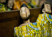 """Benin's Living Dead: The Voodoo Twins Tradition<br /> <br /> 40% of the world's twins are born in Africa. Benin's Fon people have one of the highest occurrences at 1 in 20 births. The high rate of infant mortality and voodoo religion, Benin's national religion, have begot some very particular practices concerning the deaths of one or both of these twins. In many other societies, twins are regarded as bad omens and often killed or abandoned at birth. However, in the Fon culture, twins have always been revered because Nana Buluku, voodoo's androgynous creator of the universe, gave birth to twins. These twins in turn created the voodoo deities that run the world.<br /> <br /> Once a twin dies, a wooden statue called the """"hohovi"""" is carved, within which the spirit of the dead child is placed. These figurines are deified and treated almost exactly like the living children. For the Fon, twins are immortal. They continue to live even after their death, bringing blessings or misfortune depending on if there are either pampered or abused.<br /> <br /> Three months after the birth of twins, if they are still living, the parents go collect gifts from other members of their community. If one or both of the twins die, then the mother carries the statues around between her breasts and walks around with a tray on her head, receiving alms for the twins.  All donate some money or food. The mother may even take some wares on display at the market. If a woman is rich or powerful, then she sends someone to conduct this collection in her place. <br /> <br /> In Bopa, a village situated on the banks of Lake Aheme in southern Benin, Dah Tofa and his wife reside. Dah Tofa, an educated man in his 60s, is a voodoo priest. His wife, who is around 40 years old, speaks only Fon. I ask for her name and she tells me the name she was born with, but this causes a bit of an incident. Her husband explains that she was supposed to say """"Hounyoga"""", the name of the voodoo goddess she worships whose name """
