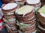 Fresh cheese wrapped in woven bamboo for sale at the morning market in the Zapotec village of Teotitlan del Valle, Oaxaca, Mexico on 26 November 2018