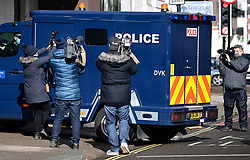 © Licensed to London News Pictures. 13/03/2021. London, UK.  Media surround a heavily armoured police vehicle carrying a prisoner in to Westminster Magistrates Court where murder suspect Wayne Couzens is due to appear. Couzens, A serving Met Police officer, has been charged with with the kidnap and murder of Sarah Everard, who disappeared as she walked home in Clapham, south London. The body of Sarah Everard was later discovered woodland in Kent more than a week after she was last spotted on 3 March. Photo credit: Ben Cawthra/LNP