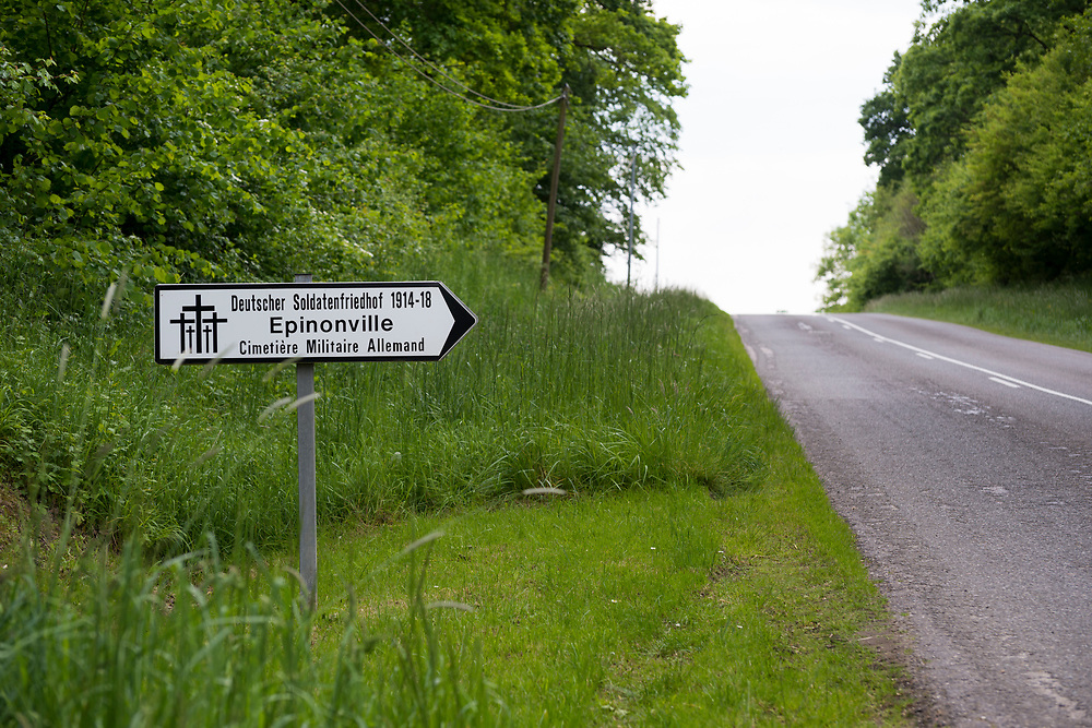 Sign poining toward the German war cemetery in Epinonville, west of Verdun, France. The area was the scene of much fighting during World War I.