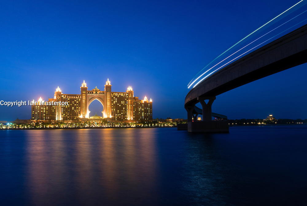 View of The Palm Atlantis luxury hotel and monorail train on artificial Palm Jumeirah island in Dubai United Arab Emirates