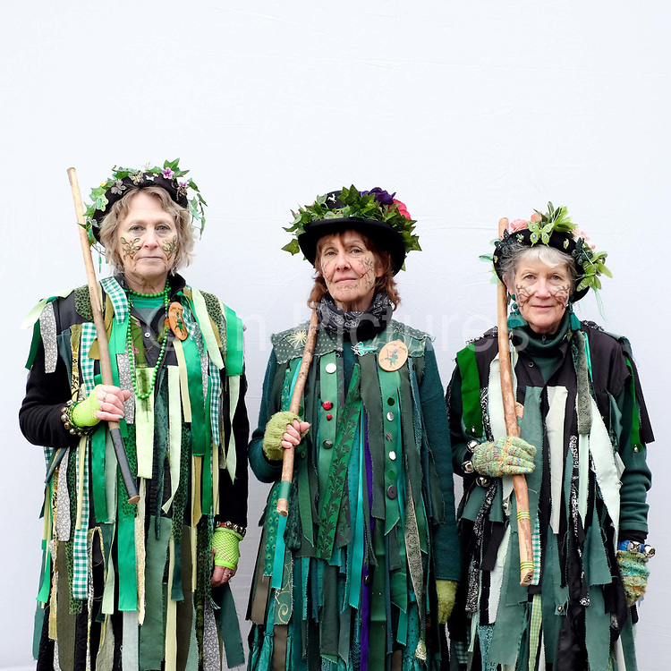Portrait of a Makara Morris dancers wearing traditional costume at an orchard-visiting wassail at Sledmere House in the Yorkshire Wolds, United Kingdom on 20th January 2018. Wassail is a traditional Pagan winter celebration in cider-producing regions of England, reciting incantations and singing to the trees to promote a good harvest for the coming year. Pieces of toast soaked in cider are hung in the branches to attract robins to the tree as these are said to be the good spirits of the orchard. To ward off evil spirits, villagers scare them away by banging pots and pans and making as much noise as possible