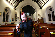 """EXCLUSIVE<br /> Vicar by day Punk Rock star by Night<br /> <br /> AN East Lancashire vicar is swapped hymns for rock music as he launches a bid for chart success.<br /> Rocking reverend Philip Chew, vicar of St Stephen's CofE Church, Oxford Road, Burnley, and his rock band Revisit are to release a single.<br /> Lead singer Philip, bassist Mark Hurlbut, from Accrington; John Mayor, drums, from Darwen, and lead guitarist, Graham Chapel from Langho formed Revisit six months ago.<br /> Now the band is hoping to release its single We're Under Attack in the next six weeks.<br /> The band, all in their 40s, hopes to get the record played on national radio, but members are remaining tight-lipped about how discussions are going.<br /> Philip writes the songs and uses themes such as morals and encouraging community under-standing.<br /> He said he had been told his singing style and music was similar in sound to The Smiths and U2.<br /> To gauge public opinion Revisit performed its first live gig to young people at the Play Centre, Dall Street, Burnley.<br /> Philip said: """"I think it is a misconception that a vicar should just be spending his time in church.<br /> """"In Christianity a priest is supposed to be in the world and that's what I am doing.<br /> <br /> """"We have been back together for about six months but this was the first proper gig we have done.<br /> """"We decided to play for the kids to see what they thought and we wanted to give something back to the young people because they do not often see live music in Burnley and going to gigs is expensive.<br /> """"The concert went really well, there was a good atmosphere and it got better as it went along. Everybody enjoyed themselves.""""<br /> The gig included Revisit's own material as well as covers including songs from American punk rockers Green Day and David Bowie.<br /> Philip and Graham, who runs an engineering business, enjoyed limited success and toured the north-west in the post punk era of the 1980s as part of the ban"""