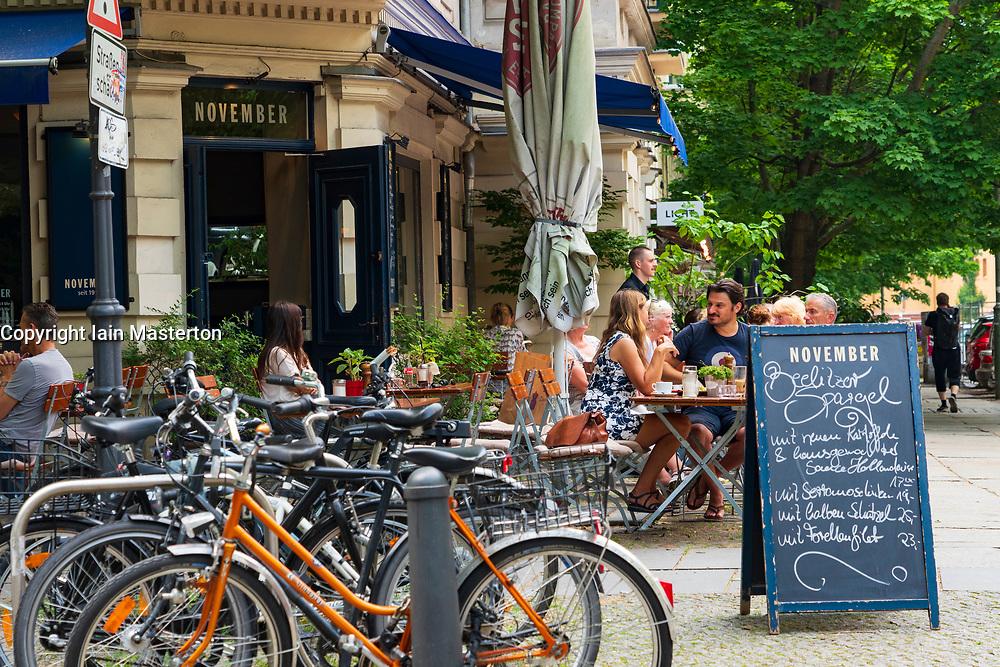 Busy cafe November in summer in Prenzlauer Berg in Berlin, Germany
