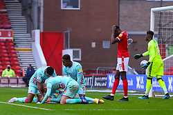 Connor Roberts of Swansea City is congratulated by team mates after scoring his side's opening goal - Mandatory by-line: Nick Browning/JMP - 29/11/2020 - FOOTBALL - The City Ground - Nottingham, England - Nottingham Forest v Swansea City - Sky Bet Championship