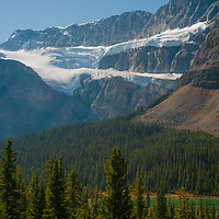 Crowfoot Mountain rises above Crowfoot Glacier and the Bow River Valley in Banff National Park, Alberta, Canada.