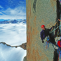 Rick Ridgeway relaxes at a belay station on the first ascent of Rakekniven Spire in Queen Maud Land, Antarctica.
