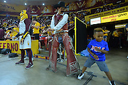 March 18, 2016; Tempe, Ariz;  Pistol Pete dances with young fan during a game between No. 2 Arizona State Sun Devils and No. 15 New Mexico State Aggies in the first round of the 2016 NCAA Division I Women's Basketball Championship in Tempe, Ariz. The Sun Devils defeated the Aggies 74-52.