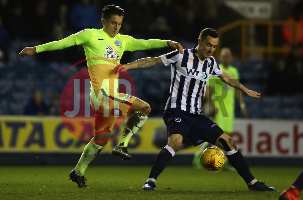 Tom Nichols of Peterborough United battles with Shaun Williams of Millwall - Mandatory by-line: Joe Dent/JMP - 28/02/2017 - FOOTBALL - The Den - London, England - Millwall v Peterborough United - Sky Bet League One