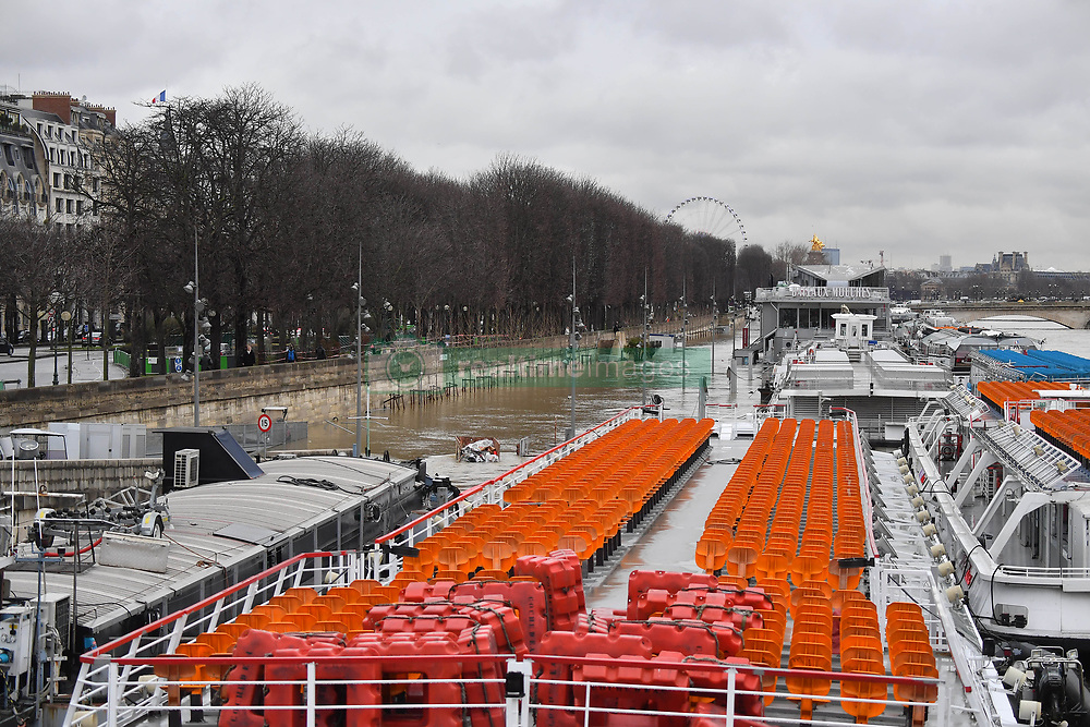 River banks are under water as Seine river keep on rising in Paris, France on January 25, 2018. The River Seine continued to rise in Paris on Thursday as it headed toward the 6-metre mark. The capital's famous museums were taking emergency measures and transport authorities said part of a major train line would remain closed for a week. Heavy rains have lashed France for days, leaving 30 departments across the country on flood alert. Some towns and villages in the east are already inundated, leaving homes and shops filled with muddy water. The Seine, running through the centre of the French capital, had already burst its banks in some places Monday, growing into a powerful muddy torrent that has submerged riverside parks and footpaths. Photo by Christian Liewig/ABACAPRESS.COM