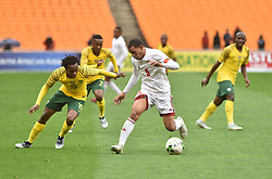 South Africa: Johannesburg: Bafana Bafana player Percy Tau battle for the ball with Seychelles player Jones Joubert during the Africa Cup Of Nations qualifiers at FNB stadium, Gauteng.<br />Picture: Itumeleng English/African News Agency (ANA)