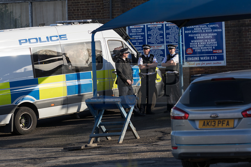 © Licensed to London News Pictures. 05/06/2017. LONDON, UK.  Police officers and vans at the rear of the Ship and Shovel pub in Dagenham this morning. One of the vans is believed to be containing terror suspects. Police carried out a raid at a Dagenham address early this morning in connection with the London Bridge terror attacks and residents reported hearing gun shots.  Photo credit: Vickie Flores/LNP
