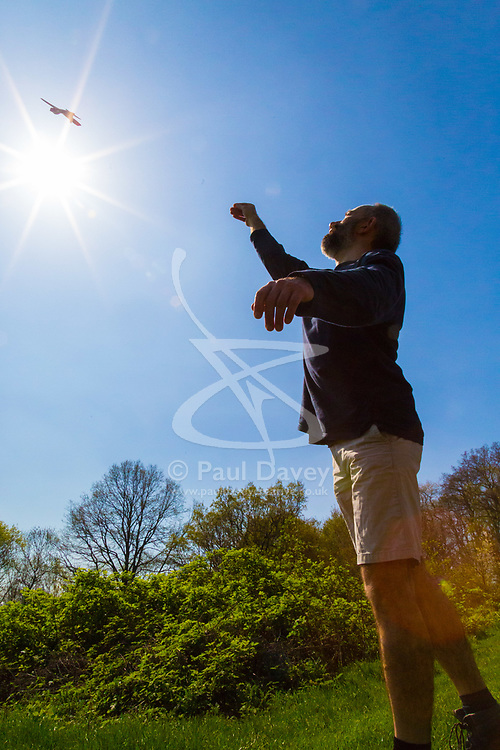 The hot sun looks down as a man flies his glider on Parliament Hill in London February 10 2018.