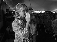 Sunday session of the Sisters Folk Festival<br /> <br /> Sara Hickman during a moment of silence at the Community Celebration