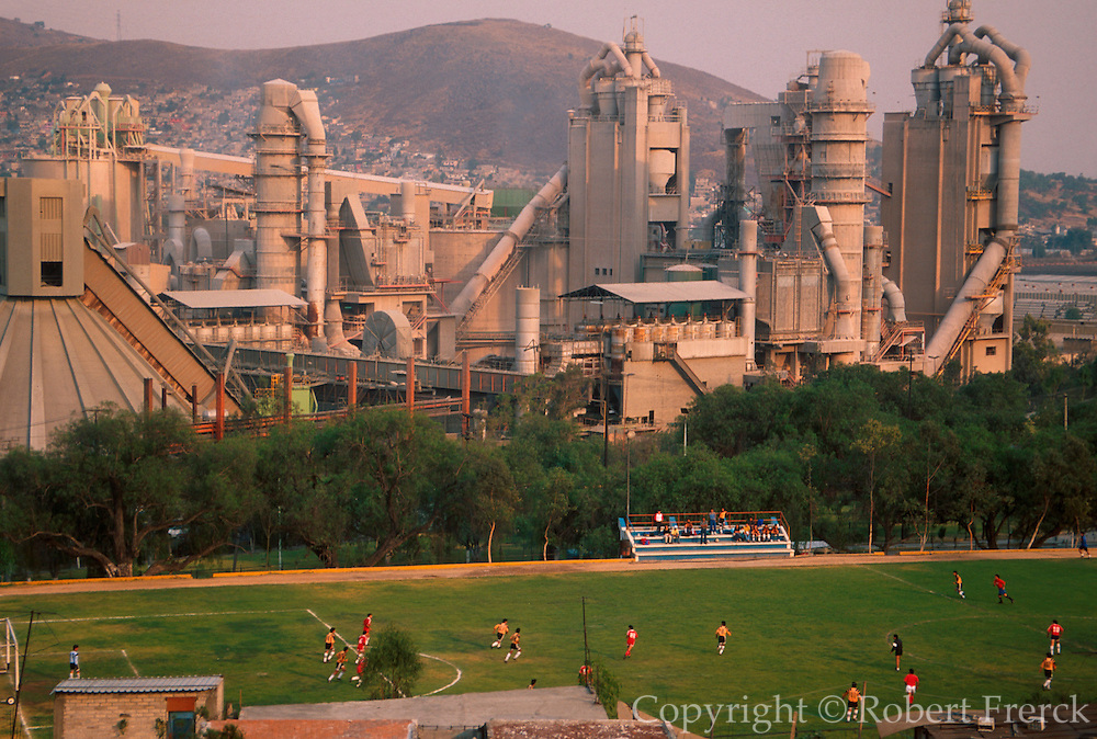 MEXICO, MEXICO CITY, INDUSTRY Cement plant and surrounding community including soccer field in Tlalnepantla area north of city