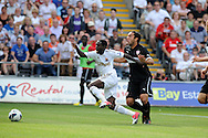 Swansea city's Nathan Dyer (c) is brought down for a penalty.  Pre-season friendly match, Swansea city v FC Stuttgart at the Liberty Stadium in Swansea, South Wales on Saturday 11th August 2012. pic by Andrew Orchard, Andrew Orchard sports photography,