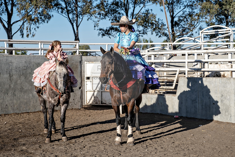 Analia Franco de Anda, left, and her sister Saray Franco de Anda during the family Charreria practice session in the Jalisco Highlands town of Capilla de Guadalupe, Mexico. The Franco family has dominated Mexican rodeo for 40-years and has won three national championships, five second places and five third places.