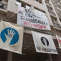 Signs hang on the facade of the school as students  demonstrate their support for the autonomy of the University of Theatre and Film Arts (SZFE) in Budapest, Hungary on Sept. 1, 2020. ATTILA VOLGYI