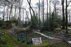 Wendover, UK. 9th April, 2021. Fencing is used to divide two areas of Jones Hill Wood, ancient woodland said to have inspired Roald Dahl, during tree felling operations for the HS2 high-speed rail link. Tree felling work began this week, in spite of the presence of resting places and/or breeding sites for pipistrelle, barbastelle, noctule, brown long-eared and natterer's bats, following the issuing of a bat licence to HS2's contractors by Natural England on 30th March.