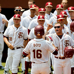 June 06, 2011; Tallahassee, FL, USA; Florida State Seminoles first baseman Jayce Boyd celebrates with teammates following a two run homerun during the eighth inning of the Tallahassee regional of the 2011 NCAA baseball tournament game against the Alabama Crimson Tide as play resumed following the suspension of play due to severe weather last night at Dick Howser Stadium. Florida State defeated Alabama 11-1 to advance to a super regional.  Mandatory Credit: Derick E. Hingle