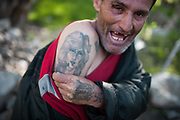 A heroin addict. Heroin trafficking between Afghanistan and Tajikistan is a big issue. <br /> <br /> The town of Khorog (2200m), is the capital of the Gorno-Badakhshan Autonomous Province (GBAO) in Tajikistan. It is situated in the Pamir Mountains (ancient Mount Imeon) at the confluence of the Gunt and Panj rivers.<br /> The city is bounded to the south and to the north by the deltas of the Shakhdara and Gunt rivers, respectively. The two rivers merge in the eastern part of the city flow through the city, dividing it almost evenly until its delta in the river Panj, also being known as Amu Darya, or in antiquity the Oxus on the border with Afghanistan. Khorog is known for its beautiful poplar trees that dominate the flora of the city.<br /> Khorog is one of the poorest areas of Tajikistan, with the charitable organization Aga Khan Foundation providing almost the only source of cash income. Most of its inhabitants are Ismaili Muslims.<br /> <br /> Tajikistan, a mountainous landlocked country in Central Asia. Afghanistan borders it to the south, Uzbekistan to the west, Kyrgyzstan to the north, and People's Republic of China to the east. Tajikistan also lies adjacent to Pakistan separated by the narrow Wakhan Corridor.<br /> Tajikistan became a republic of the Soviet Union in the 20th century, known as the Tajik Soviet Socialist Republic.<br /> It was the first of the Central Asian republic to gain independence in December 1991.