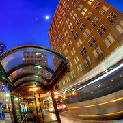 Buses in motion at the 10th and Main transit center in downtown Kansas City, Missouri.