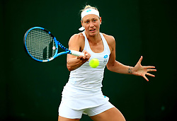 Yanina Wickmayer in action against Rebecca Peterson on day one of the Wimbledon Championships at the All England Lawn Tennis and Croquet Club, Wimbledon.