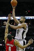 December 23, 2009; San Antonio, TX USA; San Antonio Spurs forward Tim Duncan (21) shoots over Portland Trailblazers forward Juwan Howard (6) in the fourth period at the AT&T Center. The Blazers won 98-94. Mandatory Credit: Thomas Campbell-US PRESSWIRE