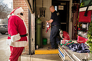 19 DECEMBER 2020 - SAYLOR TOWNSHIP, IOWA: SANTA CLAUS arrives at the Saylor Township fire department. The Saylor Township Fire Department welcomed Santa Claus to the township on the north edge of Des Moines by showing him around town a fire engine. The event was organized by the Fire Deparment for the town's youngsters who won't be able to see Santa this year because of the Coronavirus pandemic.     PHOTO BY JACK KURTZ