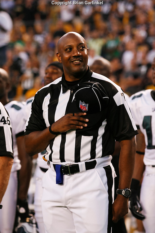 NFL Side Judge Keith Washington #7 during the singing of the national anthem before the preseason game between the Philadelphia Eagles and the Pittsburgh Steelers. The Steelers won 24-14 at Heinz Field in Pittsburgh, Pennsylvania on Thursday August 18th 2011. (Photo By Brian Garfinkel)