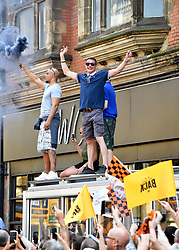 Supporters let off flares and wave flags ahead of the winner's parade through Wolverhampton.