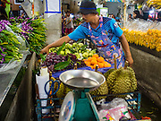 25 AUGUST 2016 - BANGKOK, THAILAND: A fruit vendor in Pak Khlong Talat, the flower market in Bangkok.         PHOTO BY JACK KURTZ