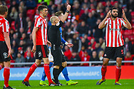 Alim Ozturk of Sunderland (5) is sent off by Andy Woolmer (Referee) during the EFL Sky Bet League 1 first leg Play Off match between Sunderland and Portsmouth at the Stadium Of Light, Sunderland, England on 11 May 2019.