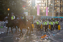 © Licensed to London News Pictures.  07/07/2021. London, UK. Police patrol while England football supporters arrive at Wembley Stadium, west London ahead of their EURO 2020 match against Denmark this evening. Photo credit: Marcin Nowak/LNP