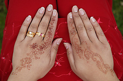 Hands decorated with henna and jewellery at the Nottingham Mela,