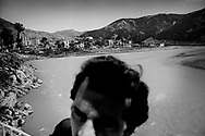 1/4: Man by the river / The town of Rubik in Northern Albania