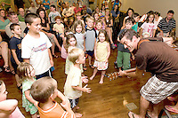 Musician Paul Warnick sings and dances along with the children who have participated in the Gilford Summer Reading program on Tuesday evening.  (Karen Bobotas/for the Laconia Daily Sun)