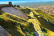 The Theatre of Pergamon ( Bergama ) is one of the steepest theatres in the world. Capable of holding a 10,000 people audience it was constructed in the 3rd century BC and underwent changes in the Roman period of Emperor Caracalla ( 211-217 AD). Pergamon (Bergama) Archaeological Site, Turkey .<br /> <br /> If you prefer to buy from our ALAMY PHOTO LIBRARY  Collection visit : https://www.alamy.com/portfolio/paul-williams-funkystock/pergamon-site-turkey.html<br /> <br /> Visit our CLASSICAL WORLD HISTORIC SITES PHOTO COLLECTIONS for more photos to download or buy as wall art prints https://funkystock.photoshelter.com/gallery-collection/Classical-Era-Historic-Sites-Archaeological-Sites-Pictures-Images/C0000g4bSGiDL9rw