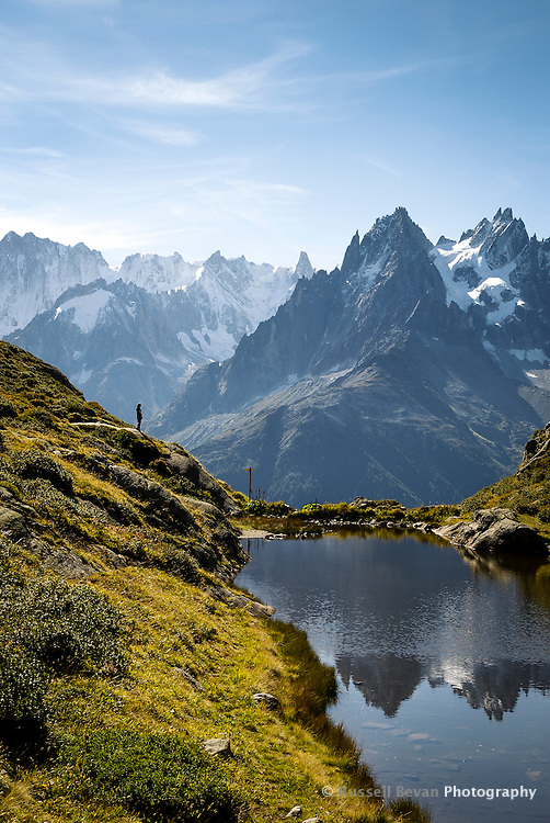A lone person looks out over the Chamonix Valley, France.