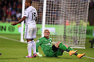 Leicester city goalkeeper Kasper Schmeichel reacts after he collides with Swansea's Wayne Routledge. Barclays Premier league match, Swansea city v Leicester city at the Liberty stadium in Swansea, South Wales on Saturday 25th October 2014<br /> pic by Andrew Orchard, Andrew Orchard sports photography.