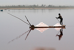February 12, 2004 - Dakar, Dakar, Senegal - A lone boatman with his take of salt from the Pink Lake (Lac Rose), Senegal. Anyone can come from anywhere in Africa to mine salt from the lake bottom. Also a popular tourist attraction and short distance from the capital of Dakar. (Credit Image: © Kenneth Martin/ZUMA Wire)