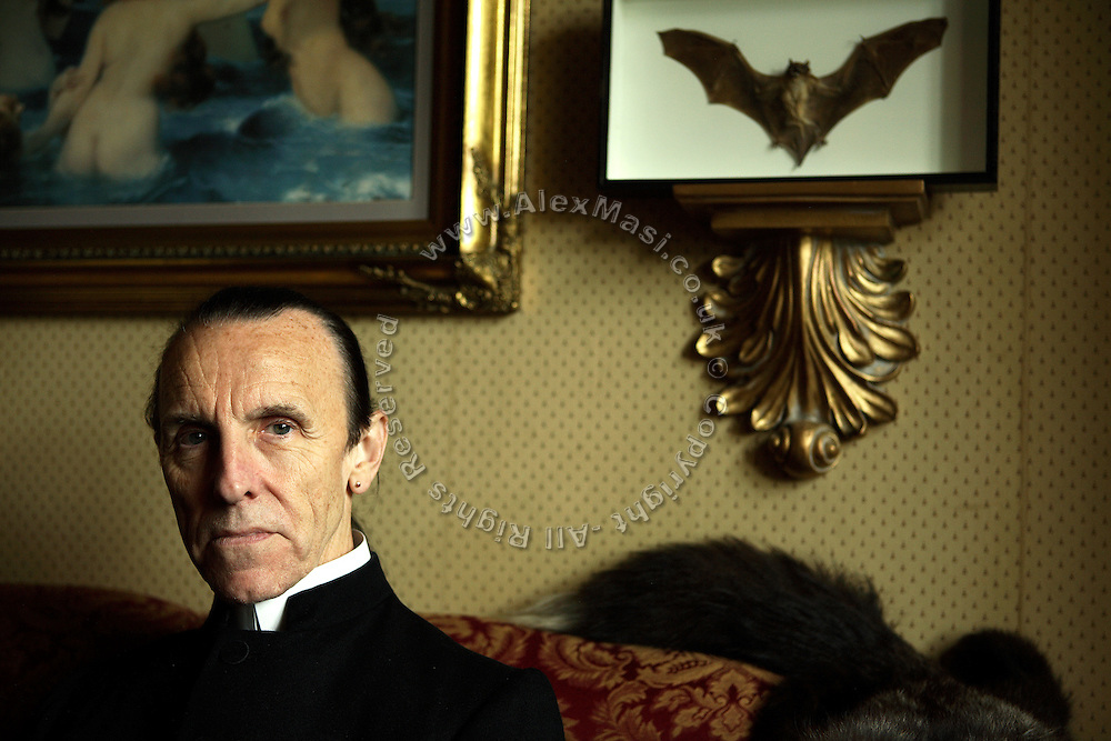 Colin, 62, the Vampyre Master portrayed in his living room on Sunday, 29 June, 2007, in his house in South London, England. He is a passionate collector of all sort of animals, religious artefacts and paintings. The Vampyre Connexion is the largest and most active of all the vampire groups in the United Kingdom, counting more than 100 members that for years have gathered regularly in London to share their common love for vampires and the Dark side of life. The Connexion raised from the hashes of the Vampyre Society, the first vampire appreciation group in 1995. The group believe in the fantasy of vampires and such creatures and live it to the full. Its  roots are to be found in the legends of Bram Stokerís Dracula. The group prints its own magazine, ëDark Nightsí featuring drawings, poetry, stories, photography and events. All of the members dress very peculiar clothing, and this is a very important part of the life of the group; it is respected with pride, taste and accuracy for the detail. Most like to dress to be elegant in a range of styles from regency to Victorian, some sew their own. In addition members visit art galleries, cemeteries, churches and cathedrals, attend gigs and concerts, and hold their own parties throughout the year, Halloween being the biggest and scariest one. Membership is open to all, the only qualification: being a love of all things Vampyric.  **ItalyOut**