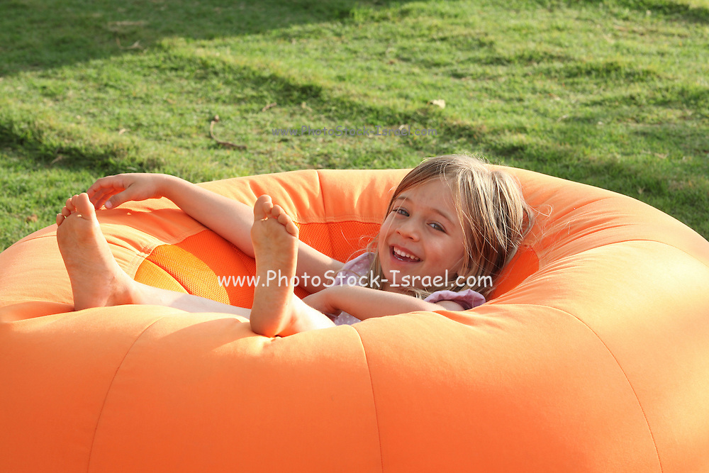 Happy Smiling Young girl on a Bean Bag