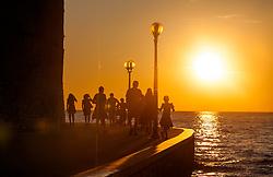 THEMENBILD - URLAUB IN KROATIEN, Touristen spazieren entlang der Strand Promenade bei Sonnenuntergang, aufgenommen am 03.07.2014 in Porec, Kroatien // Tourists walk along the beach promenade at sunset at Porec, Croatia on 2014/07/03. EXPA Pictures © 2014, PhotoCredit: EXPA/ JFK