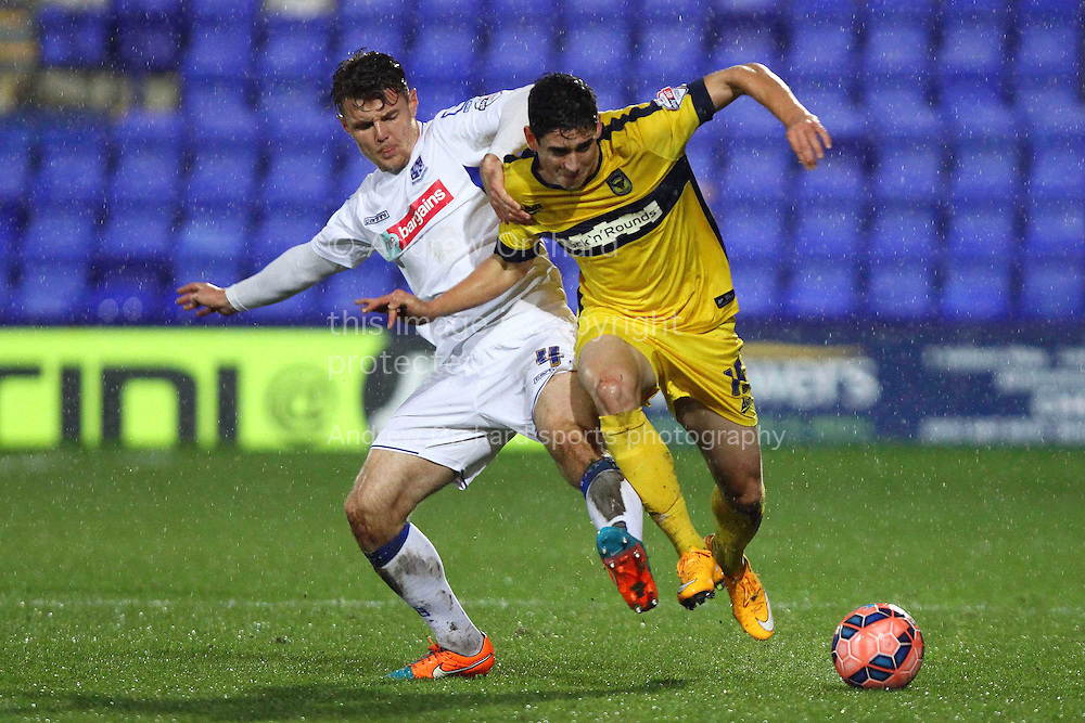 Max Power of Tranmere Rovers (l)  tackles Callum O'Dowda of Oxford United. The FA Cup, 2nd round replay, Tranmere Rovers v Oxford United at Prenton Park in Birkenhead, England on Tuesday 16th December 2014.<br /> pic by Chris Stading, Andrew Orchard sports photography.