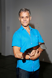 02 October 2014. Jonathan Ferrara Gallery, New Orleans, Louisiana. <br /> Jonathan Ferrara Gallery. 'Guns In The Hands Of Artists' Artist Brian Borrello. The show brings together over 30 internationally acclaimed artists who took parts from 190 destroyed weapons acquired by the New Orleans Police department  and converted them into art.  <br /> Photo; Charlie Varley/varleypix.com