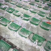 Rice powder litters the seats after the Fluminense V Sao Paulo, Futebol Brasileirao  League match at the Jornalista Mário Filho Maracana Stadium, The fans have a tradition of throwing rice powder as the team takes the field in honour of Carlos Alberto, a player of mixed race ethnicity who, in 1914, attempted to lighten his skin by covering himself in rice powder on debut for his team. Unfortunately his sweat washed the powder off during the match and he was jeered by the opposing supporters..Rio de Janeiro,  Brazil. 29th August 2010. Photo Tim Clayton.