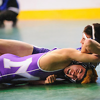 022214  Adron Gardner/Independent<br /> <br /> Toshio Herrera, left, survives Piedra Vista Panther Dylan Greenhaus in the 4A 106-pound semi-final during the state wrestling championship at the Santa Ana Star Center in Rio Rancho Saturday.  Herrera would fall to St. Pius X Sartan Gavino Hernandez in the 106-pound final.