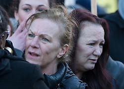 © London News Pictures. 11/01/2014. London, UK. Carole Duggan (left) and Pamela Duggan (right), the Aunt and Mother of Mark Duggan attend a vigil outside Tottenham Police Station in London, following a Coroners ruling of a lawful killing in the case of Mark Duggan earlier this week. Mark Duggan was hot dead by police in an incident that sparked riots across London and England.  Photo credit: Ben Cawthra/LNP